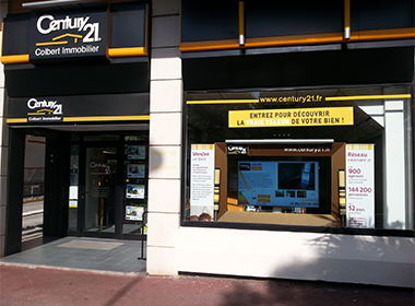 digital real estate signs, real estate digital signage, century21 office